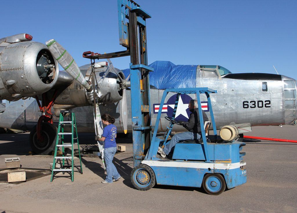Installing the newly overhauled prop on the #4 engine