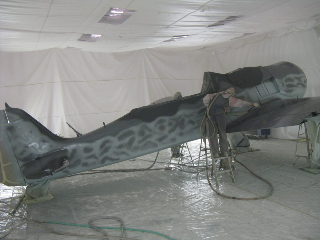 Aircraft being painted by Arizona Aeropainting