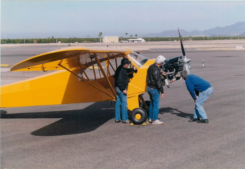 Inspecting engine after first flight