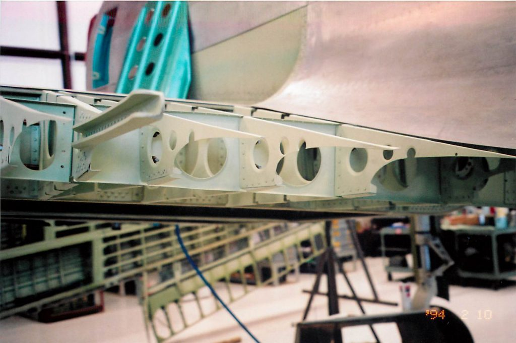 Fitting aft wing section components