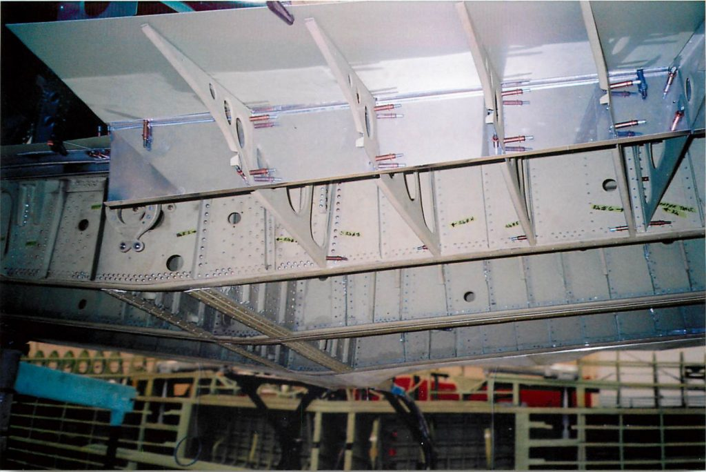 Fabricating wing sections aft of aft spar