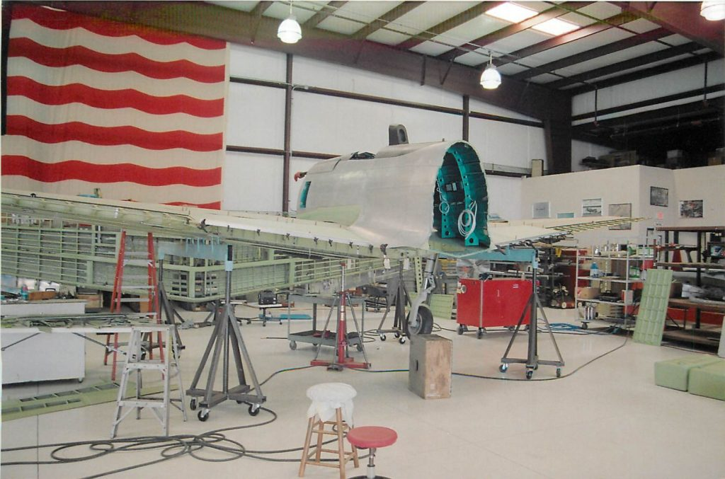 Installing cockpit section on wing center section