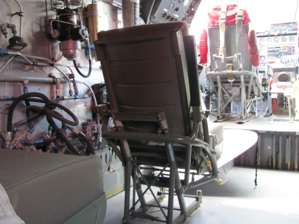 Restored seat installed on new flooring in cockpit