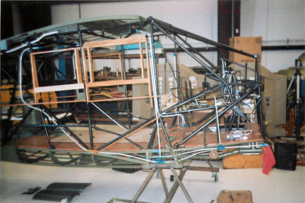 Cockpit area of fuselage frame, installing wood panels
