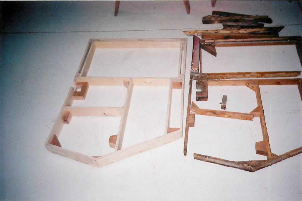 Framework for door, in fabrication process (fabrication on left, original on right)
