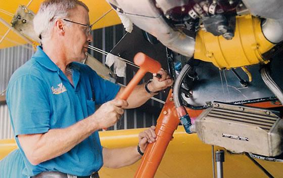 Dave Goss repairing Stearman landing gear