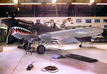 Performing general maintenance on the Curtiss P-40N