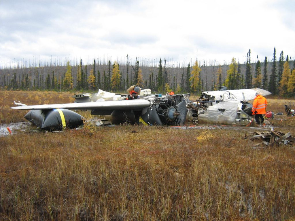 Airbags lifting aircraft out of marsh