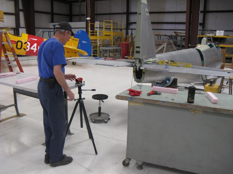 Laser alignment of elevators prior to drilling bellcrank tube