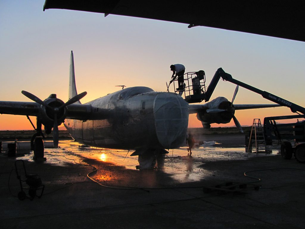 pb4y-2-2-the-privateer-being-stripped-as-the-sun-goes-down