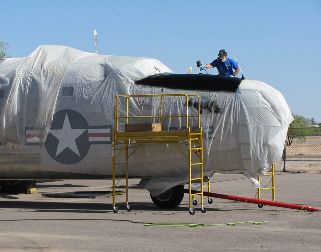 pb4y-2-8-nose-painting-the-final-coat-of-the-glare-shield